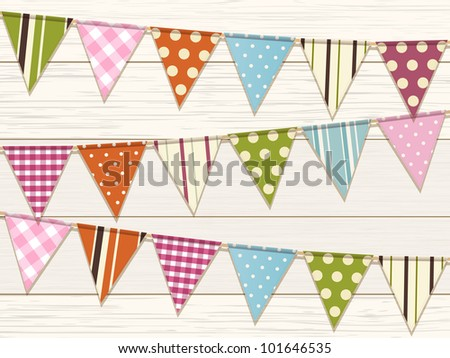 Bunting with bright patterns on a white wood background