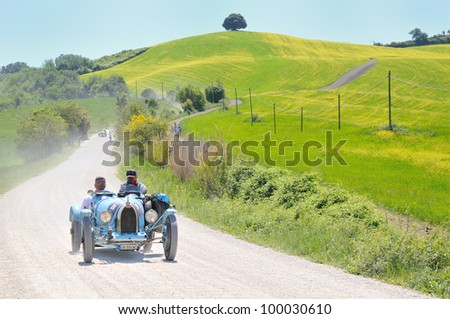 BUONCONVENTO (SI), ITALY - MAY 14 : A 1925 built light blue BUGATTI Type 35 driven by Giacomo Foglia  during a time trial at 1000 Miglia race on May 14, 2011 near Buonconvento (Siena)