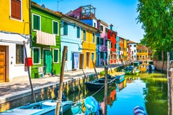 Burano island canal, colorful houses and boats, Venice Italy Europe