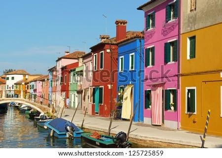 BURANO ISLAND, ITALY - AUGUST 21: Colorful houses in a row on August 21, 2012 in Burano Island, Italy. This island belongs to Venetian Lagoon.