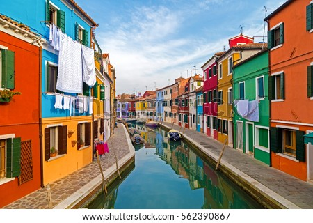 BURANO, ITALY - JANUARY 25, 2016: View of Burano, Italy, an island with colorful architecture in the Venetian Lagoon.Tourists on the streets. #562390867