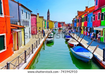 Burano, Italy - September 4, 2016 : View of the colorful Venetian houses along the canal at the Islands of Burano in Venice on September 4, 2016. #741942910