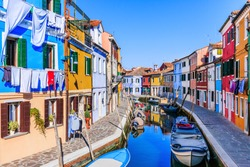 Burano, Italy. View of the colorful houses along the canal at the island of Burano near Venice.