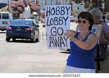 BURBANK, CA - JULY 7, 2014  A protester rallies against Hobby Lobby, protesting a recent Supreme Court decision regarding insurance coverage for certain contraceptives.