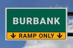 Burbank logo. Burbank lettering on a road sign. Signpost at entrance to Burbank, USA. Green pointer in American style. Road sign in the United States of America. Sky in background