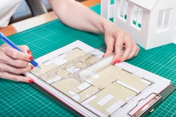 Bureau of Architecture. Construction design of buildings. Development of interior design. The process of designing a home. General plan of the building under construction. Architectural decisions.