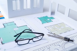 Bureau of Architecture. Drawings on the desk of an engineer. Workplace of the architect. Design of residential premises. Development of drawings of premises. Layout of the rooms. Building.