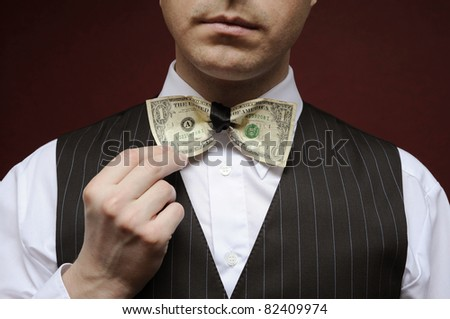 bureaucrat with bowtie made from dollar