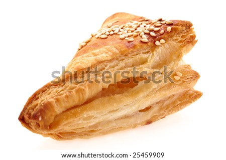 burekas - a puff pastry pie with cheese coated with sesame seeds