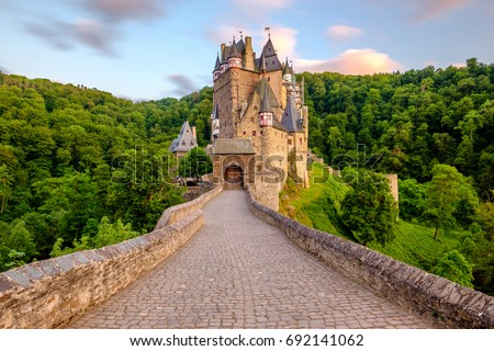 Burg Eltz castle in Rhineland-Palatinate state at sunset, Germany. Construction started	prior to 1157. stock photo