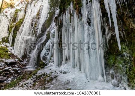 Burgbach waterfall frozen in wintertime in Germany, Bad Rippoldsau #1042878001