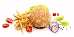 burger and fried potatoes isolated on white background, top view