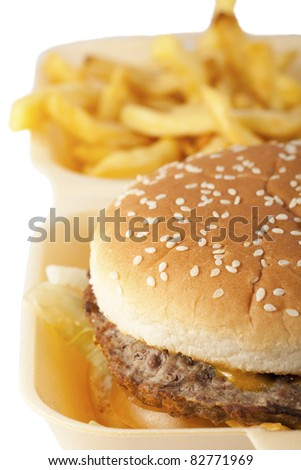 Burger and fries, white background.