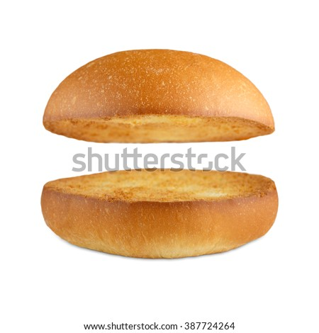 Burger bun empty isolated. American food classic burger round bread isolated at white background. Roasted toasted burger top without fillings flying, levitating at white.