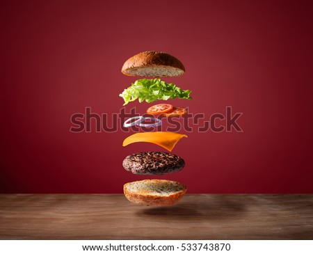 Burger floating on the wood table