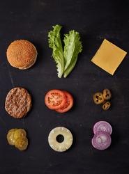 burger ingredients on dark background. top view
