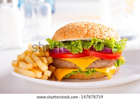 Stock Photo Burger isolated on light background. Fast food meal.