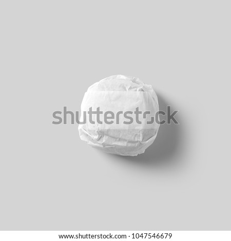 Burger packed with white background. White paper wrapping. Hamburger