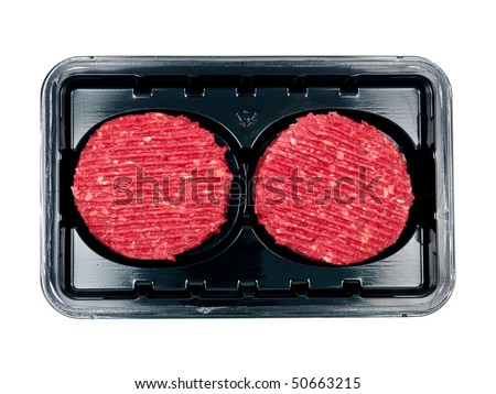 Burger patties in a supermarket packaging tray isolated on a white background