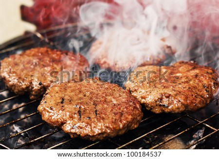 Burger patties on a grill (selective focus)
