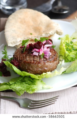 Burger with beetroot and lettuce