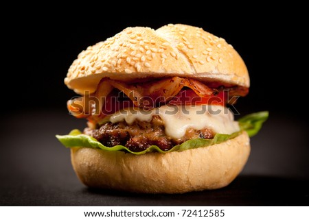 burger with cheese,lettuce and tomato
