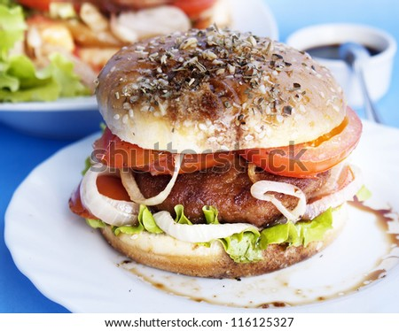 Burger with meat and baked vegetables