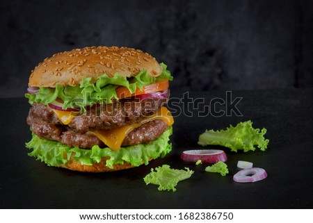 Burger with two beef patties and cheese on a dark background Stock photo ©