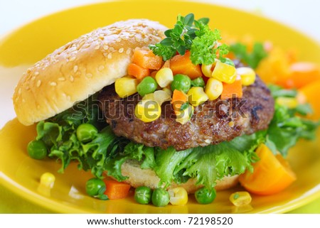 burger with vegetables and rolls