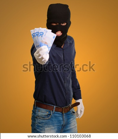 Burglar In Face Mask On Coloured Background