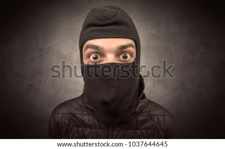 Burglar standing in black clothes and balaclava on his head. #1037644645
