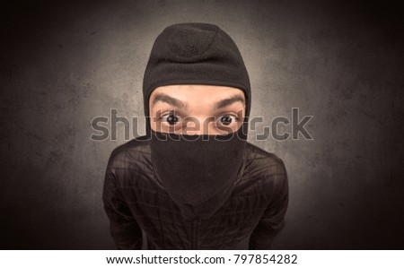 Burglar standing in black clothes and balaclava on his head. #797854282