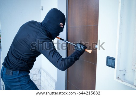 Burglar trying to force a door lock using a crowbar Сток-фото ©