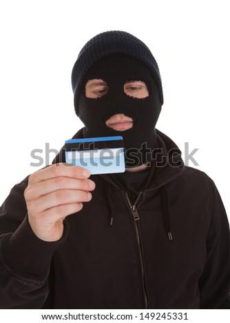 Burglar Wearing Mask Holding Credit Card Over White Background