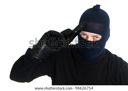 Burglar with a gun - isolated on white