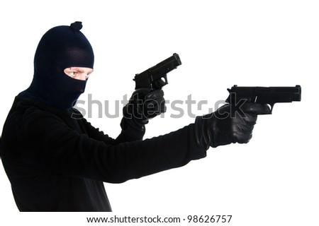 Burglar with a gun - isolated on white