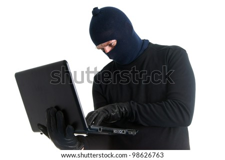 Burglar with computer - isolated on white