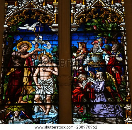 BURGOS SPAIN AUGUST 13 2014 Stained glass window depicting the Baptism of Jesus by Saint John in the cathedral of Burgos Castille Spain