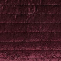 Burgundy quilted velvet fabric texture with horizontal stripes