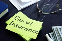 Burial Insurance memo on the green sheet and money.
