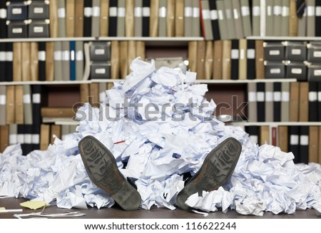 Buried in papers at the office