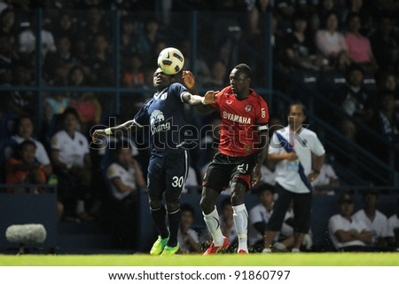 BURIRAM THAILAND-DECEMBER 31:Frank Opuku Acheapong(B)in action during Thai Premier League (TPL) between  BuriramPEA(B) and MuangThong utd (R) at I-mobile Stadium on -DECEMBER 31, 2011 Buriram Thailand