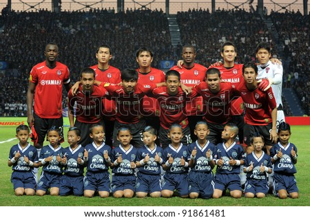 BURIRAM THAILAND-DECEMBER 31:MuangThong utd team in action during Thai Premier League (TPL) between  Buriram PEA(B) and MuangThong utd (R) at I-mobile Stadium on -DECEMBER 31, 2011 Buriram Thailand