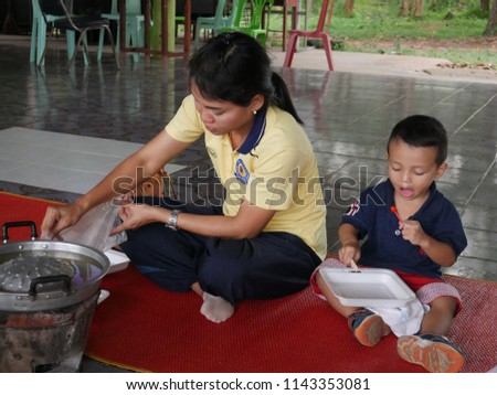 Buriram,Thailand - July 19 2018 : Nodidentical people having party by barbecue and food   for sportday at Buriram,Thailand. #1143353081