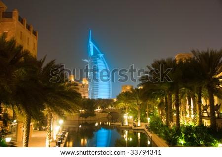 Burj al Arab at night glowing cyan