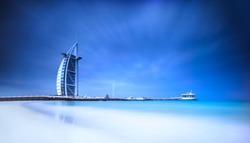 Burj Al Arab hotel on Jumeirah beach in Dubai, modern architecture, luxury beach resort, summer vacation and tourism concept