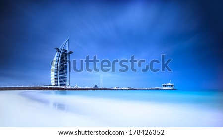 Burj Al Arab hotel on Jumeirah beach in Dubai, modern architecture, luxury beach resort, summer vacation and tourism concept #178426352