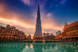 Burj Khalifa in Dubai, UAE. The tallest skyscraper building in the world, travel attraction with blue pool on foreground