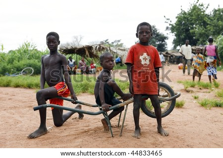 BURKINA FASO - AUGUST 12: Children of the Lobi ethnic group, children are responsible for monitoring the field and animals, August 12, 2009 in Gaoua, Burkina Faso