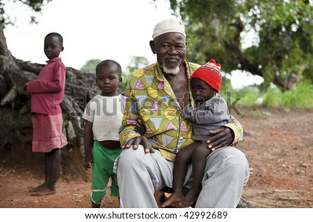 BURKINA FASO - AUGUST 12: Elder Lobi with baby, the elders have an important role making decisions on community standards, August 12, 2009 in Gaoua, Burkina Faso
